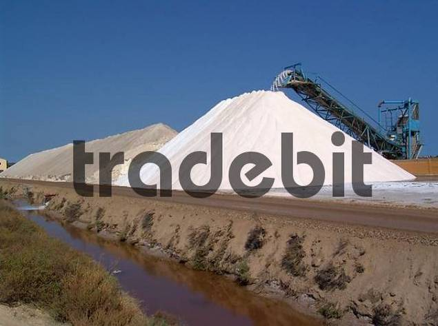 Saltworks s. Martin at the Mediterranean near Gruissan. Here by evaporation by sea water thousands tons sea salt are won and processed. The fresh salt is poured for drying on enormous dumps. Water