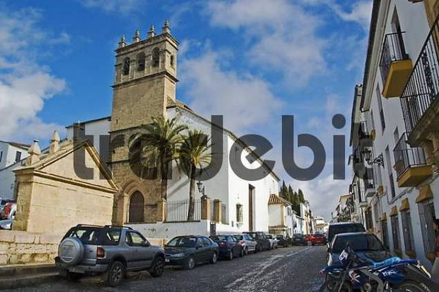 Small street and church in Granada, Andalusia, Spain
