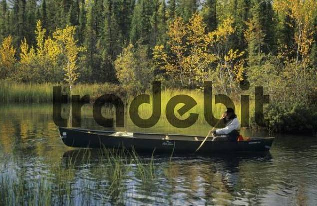 man sitting in a canoe, Northwest Territories, Canada