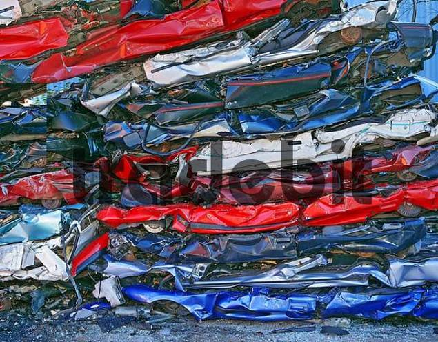 Car bodies, pressed into junk