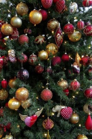 Detail shot, colourful Christmas ornaments hung on Christmas tree