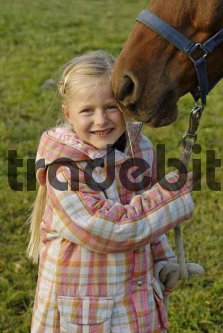 little girl with her horse