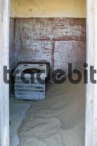 Toilet lavatory in a house in the former diamondtown ghosttown Kolmanskop in the Namib desert, Luederitz, Namibia, Africa