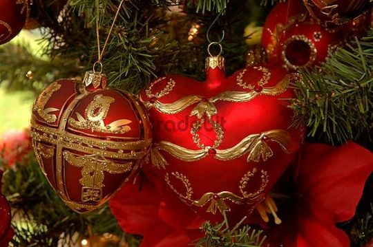 Two Red, Heart-shaped Ornaments Hanging On Christmas Tree