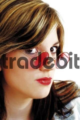 Young woman with pink sun glasses