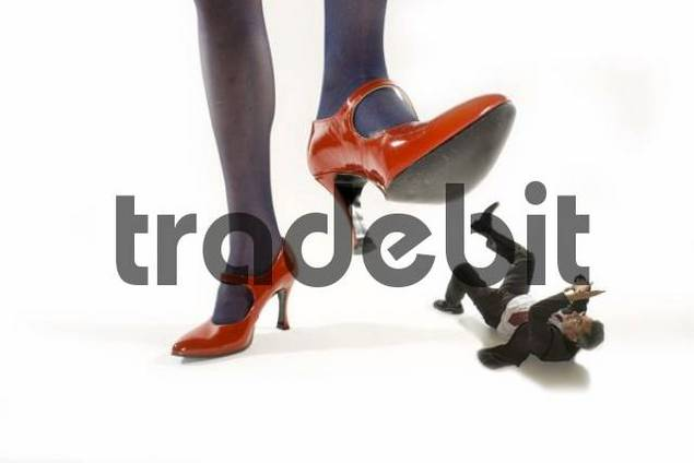 Woman Stepping On Man woman in red hi...