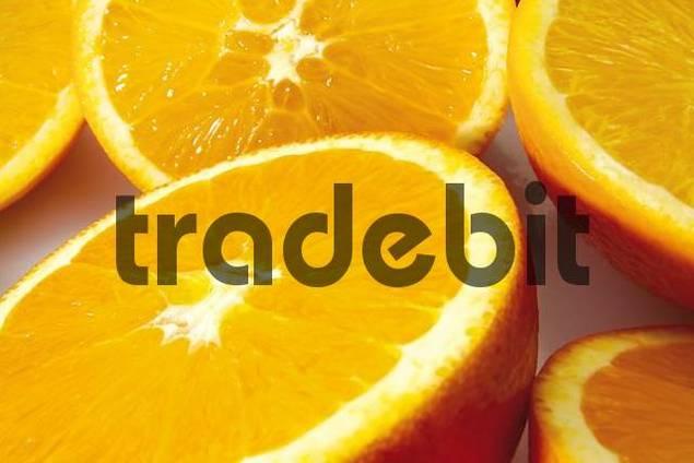 Fresh oranges, halved