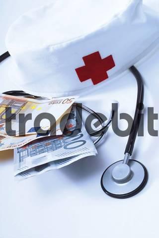 Stethoscope, nurses cap and Euro bills: symbolic for hospital fees