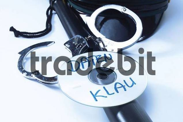 Police baton, handuffs and CD/DVD: symbolic for data theft crime
