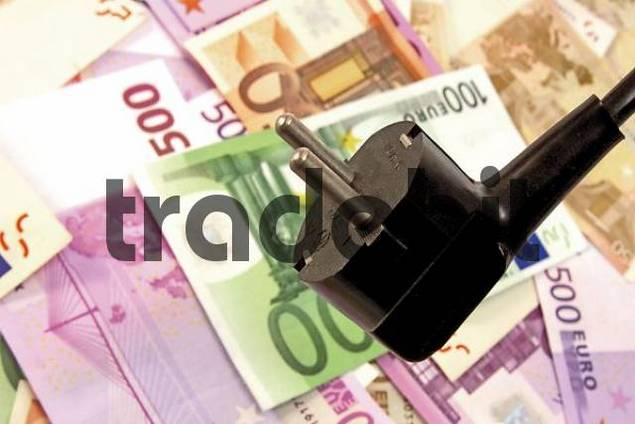 Euro bills and plug: symbol for electricity costs
