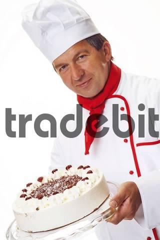 Confectioner holding a Black Forest Cake