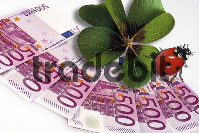 500-Euro bills with a lucky clover and a ladybug