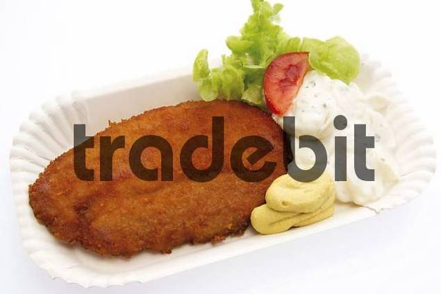 Fast food: schnitzel breaded cutlet with potato salad on a paper plate