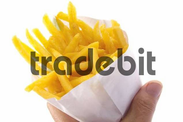Hand holding paper bag with chips