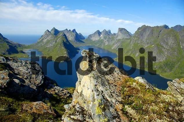 Rocks in front of rough mountain range with fjord Kjerkfjorden Moskenesoya Lofoten Norway