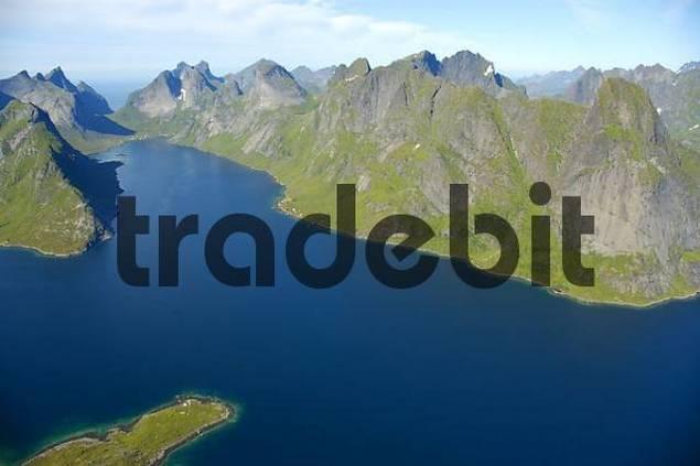 Rough mountain range with fjord Kjerkfjorden and boat Moskenesoya Lofoten Norway