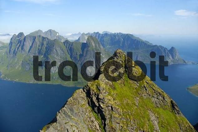 Rough summit Navaren and Reinefjorden with mountains Moskenesoya Lofoten Norway