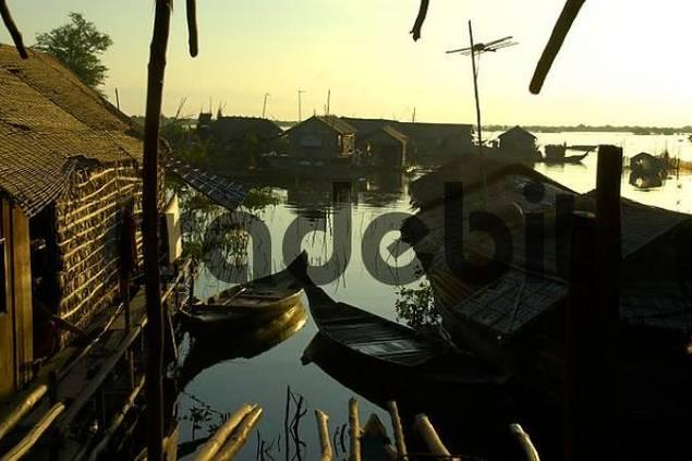 Huts made of bamboo with boats at Tonle Sap Lake Chong Kneas Cambodia