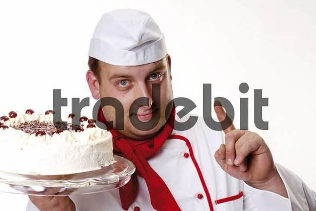 Pastry chef holding a Black Forest Cake