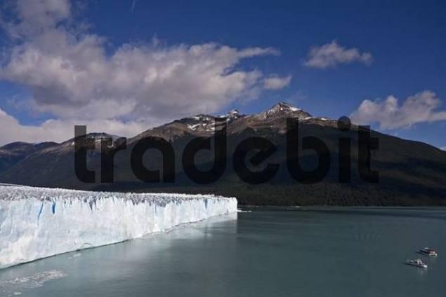 Boots in front of the glacier Perito Moreno, National Park Los Glaciares, Argentina, Patagonia, South America