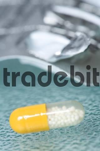 Single pill on a table