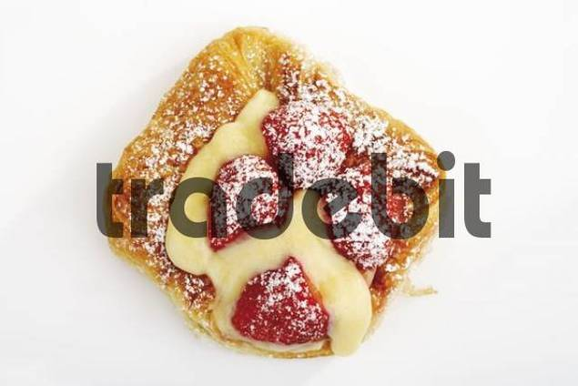 Strawberry-and-custard filo pastry covered in icing sugar