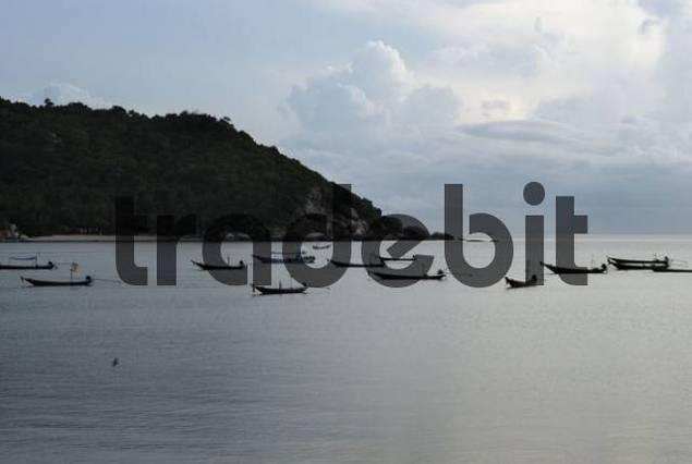 Morning mood with fishing boats in a bay, island Kho Phangan, Thailand
