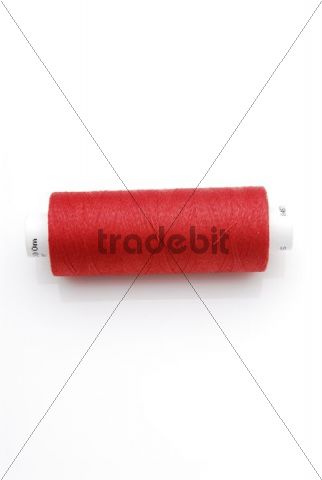 Thread spool with red thread