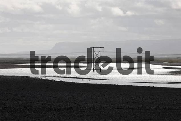Transmission mast, Skeiararsandur glacial outwash plain, southern coast of Iceland, Atlantic Ocean