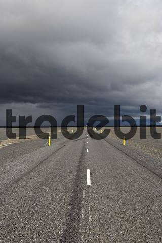 Thunderclouds forming over a highway, Skeiararsandur glacial outwash plain, southern coast of Iceland, Atlantic Ocean