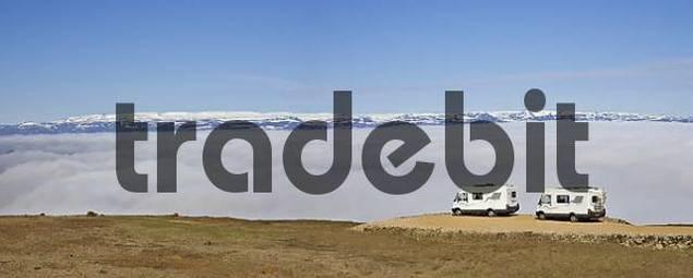 Two RVs at fog-covered Vatnsskar Pass, Bakkageri, Iceland, Atlantic Ocean