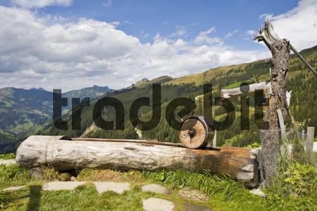 Butter churn and well on Weissalm mountain pasture, Grossarltal, near Salzburg, Austria, Europe
