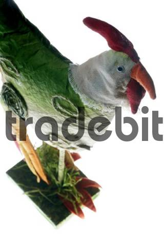 Hen made of fabric in front of a white backdrop