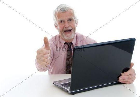 Successful senior citizen, 60+, with a laptop