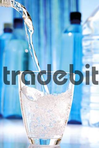 Mineral water being poured into an glass