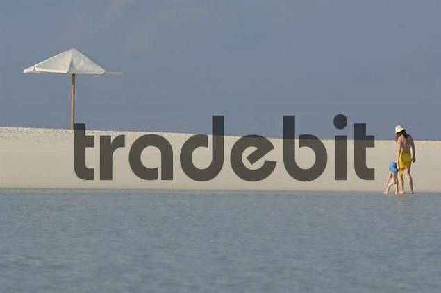 Woman with small child on the beach, Diffushi Island, Holiday Island, Southern Ari Atoll, Maldives, Indian Ocean