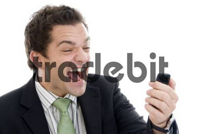 businessman screaming with mobile phone