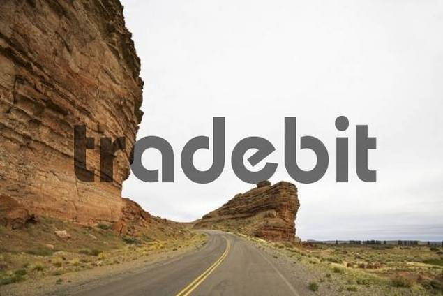 Road through the dry river bed, Rio Chubut, Patagonia, Argentina, South America