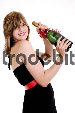 Young woman holding a champagne bottle