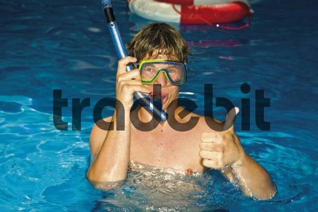 Young man in swimming pool with snorkel