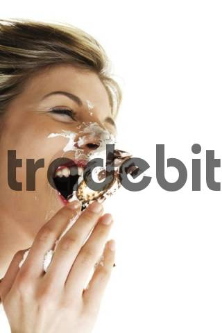 Crazy: young woman in a chocolate-covered marshmallow fight