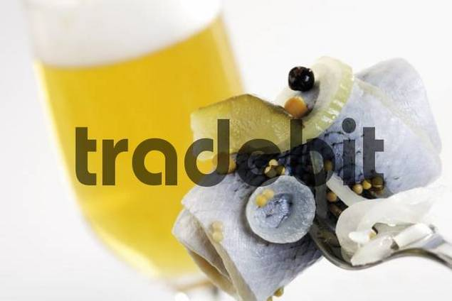 Rollmops rolled, pickled herring filet and a glass of beer