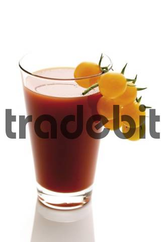Tomato juice with yellow cherry tomatoes as garnish