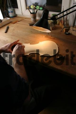 Carving, violin-making in a luthiers workshop