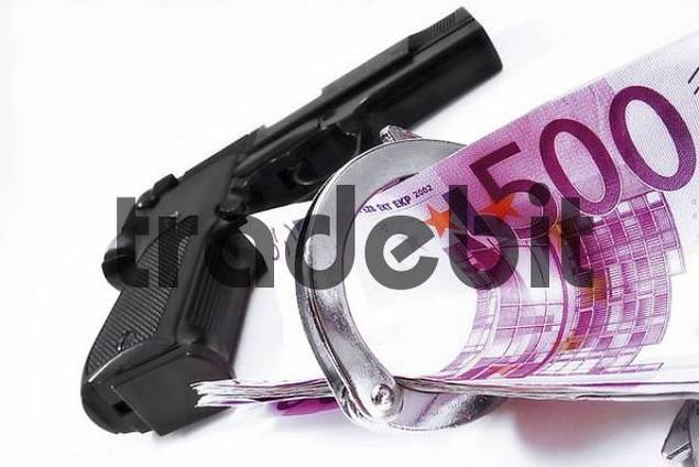 Handgun, handcuffs and cash