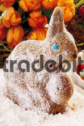 Easter bunny made of dough, sprinkled with icing sugar