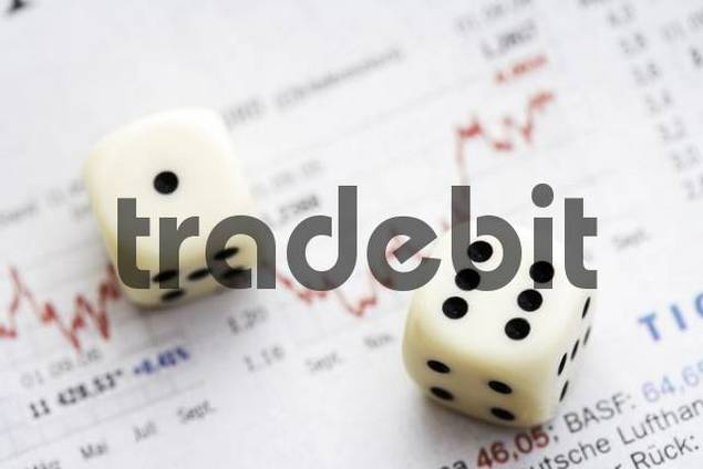 Dice on top of a financial newspaper