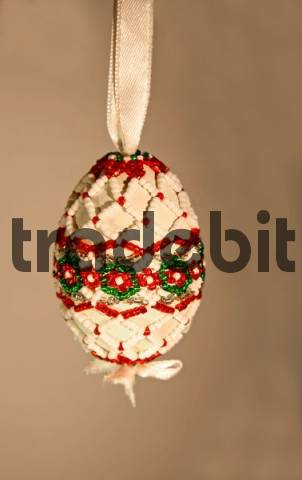 Handmade Easter egg decorated with beads, folk art, Transylvania, Hungarian art