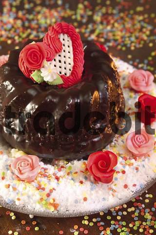 Chocolate-glazed bundt cake decorated with frosting heart