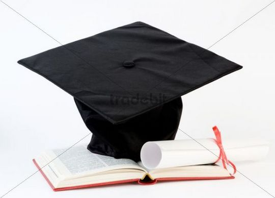 Mortarboard and certificate with open book